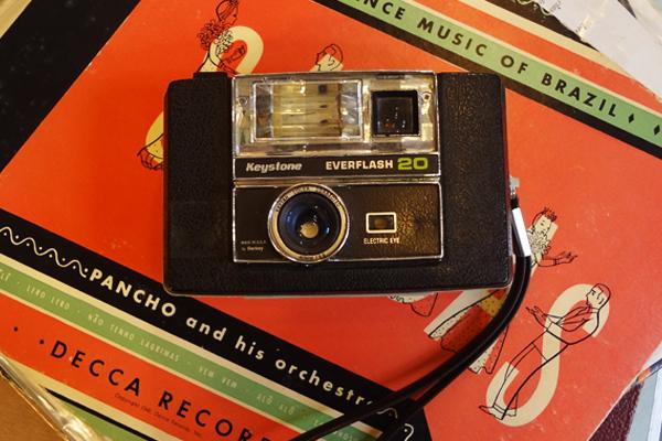 600x400--camera-and-orange--social